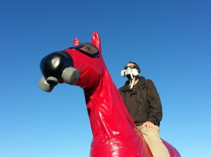Local activist riding sculpture with matching respirator.